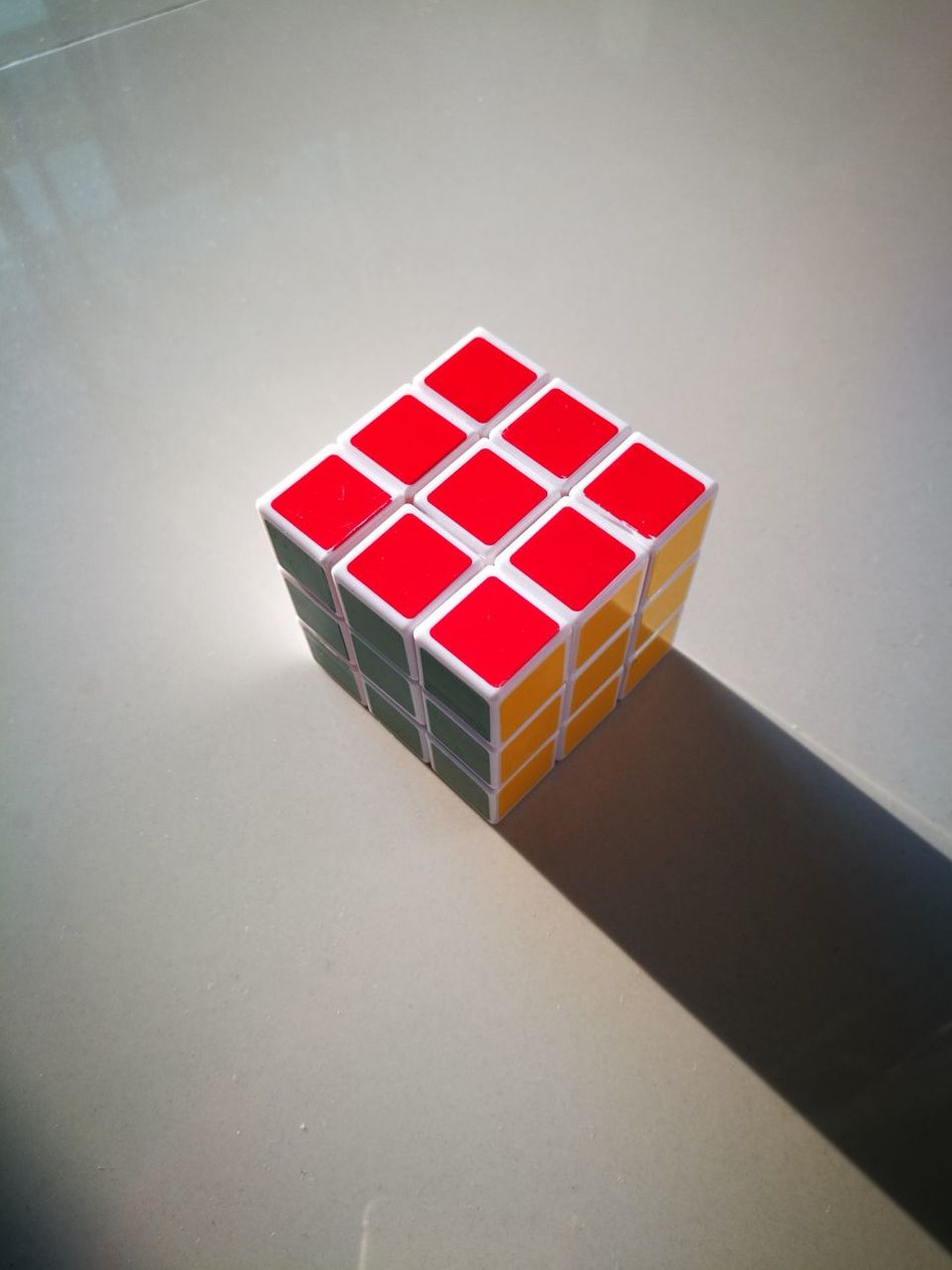 Close-up Day Gambling High Angle View Indoors  Leisure Games No People Red Rubrik Rubriks Cube Shadow