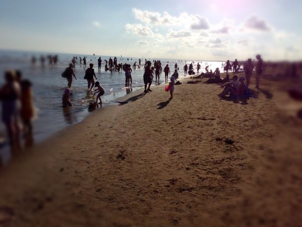 Summer on the beach. Bibione Italy Sea Summer Sky People Seaside Having Fun Clouds And Sky