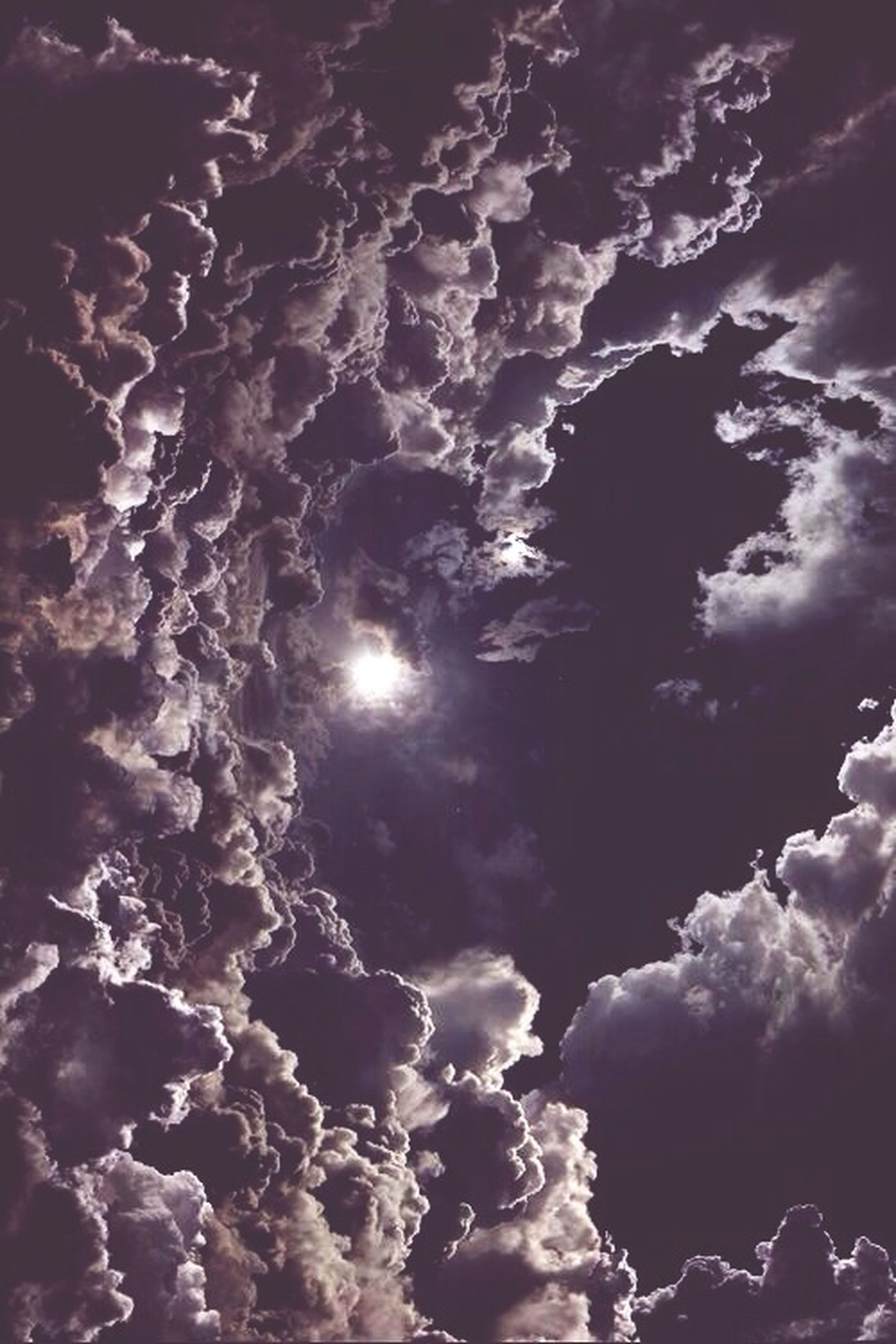 sky, low angle view, beauty in nature, tranquility, scenics, nature, tranquil scene, cloud - sky, idyllic, night, outdoors, sun, backgrounds, no people, sunlight, full frame, cloudy, glowing, majestic, tree