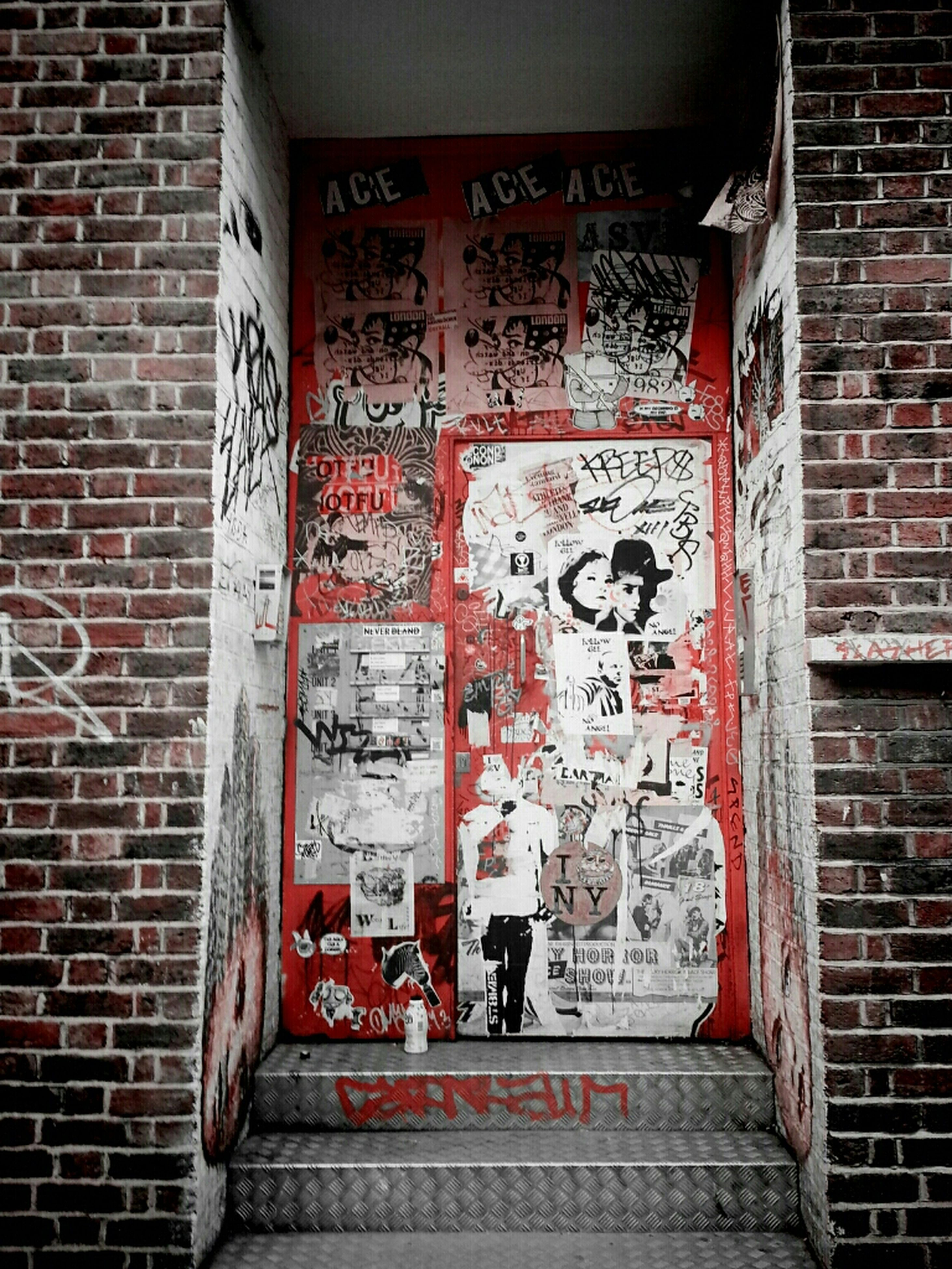 architecture, built structure, brick wall, building exterior, wall - building feature, red, text, door, closed, western script, communication, entrance, wall, steps, old, day, house, brick, weathered, window