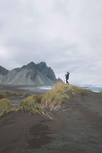 Adult Adults Only Beach Beauty In Nature Black Black Sand Beach Day Full Length Iceland Landscape Men Mountain Nature One Man Only One Person Only Men Outdoors People Photography Themes Sand Sand Dune Scenics Sky Trip Vacation