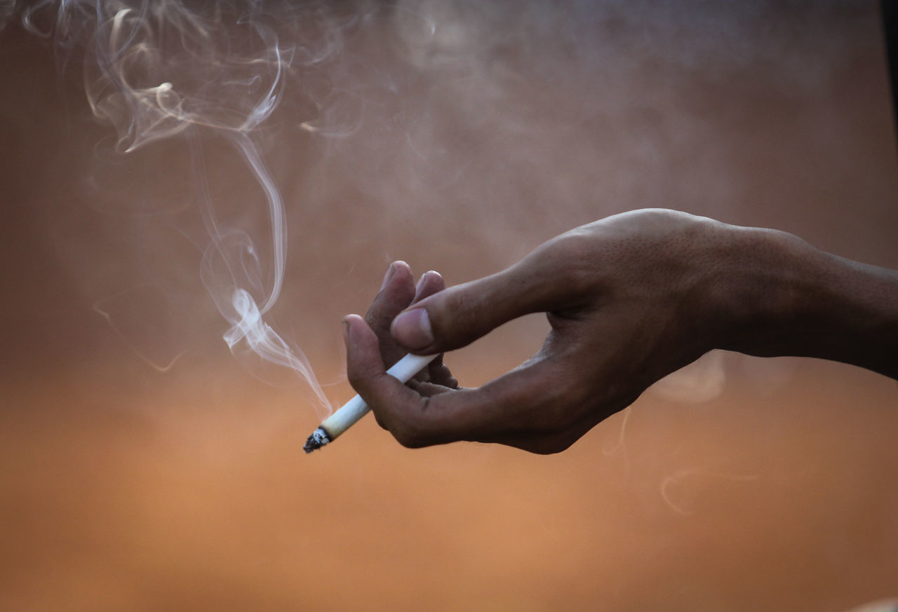 Close-up of a hand holding cigarette Cigarette  Smoking Bad Habit Close Up