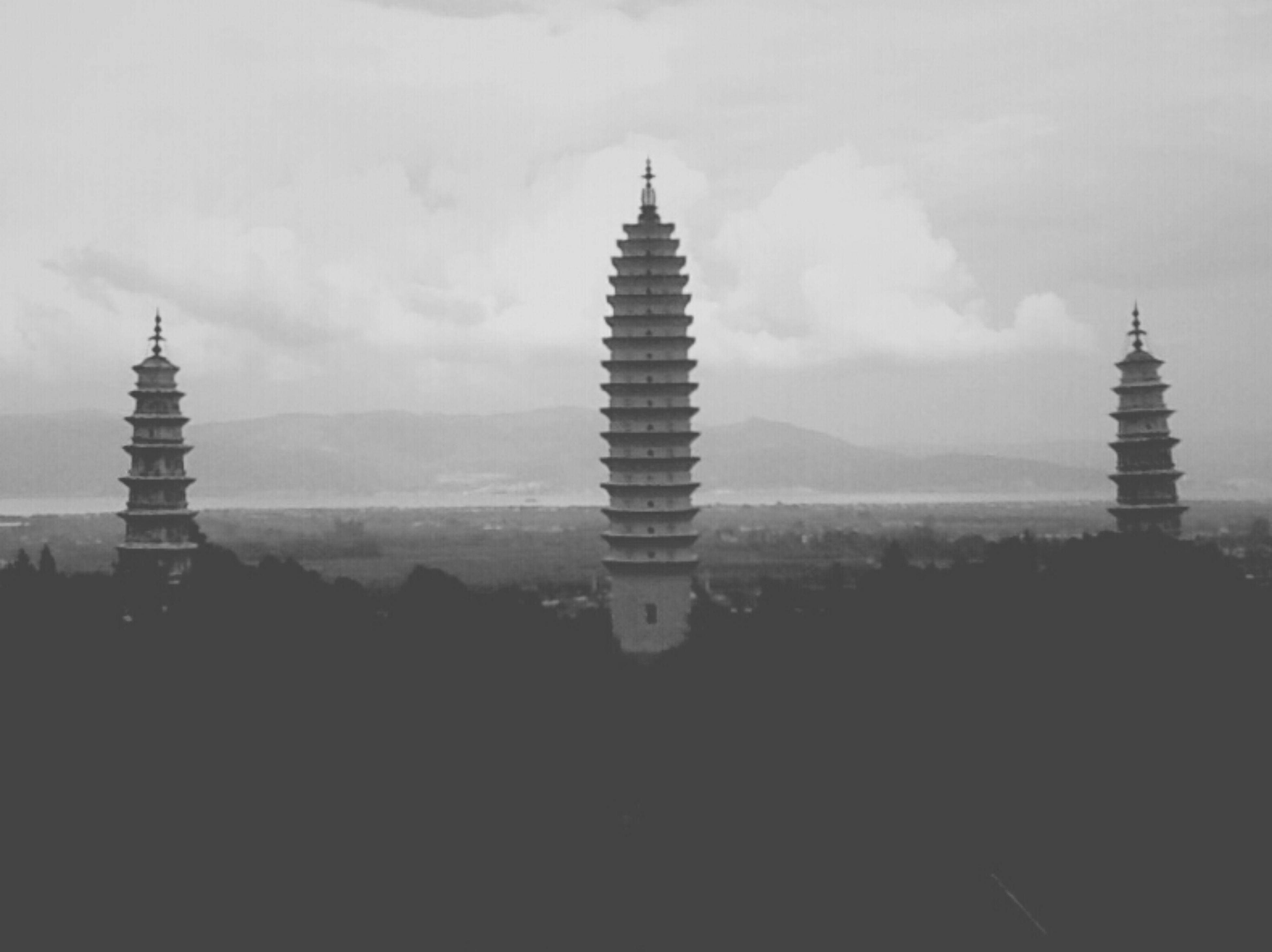 architecture, sky, built structure, building exterior, tower, tranquility, cloud - sky, famous place, tranquil scene, travel destinations, scenics, tall - high, nature, outdoors, history, silhouette, tourism, no people, beauty in nature, water