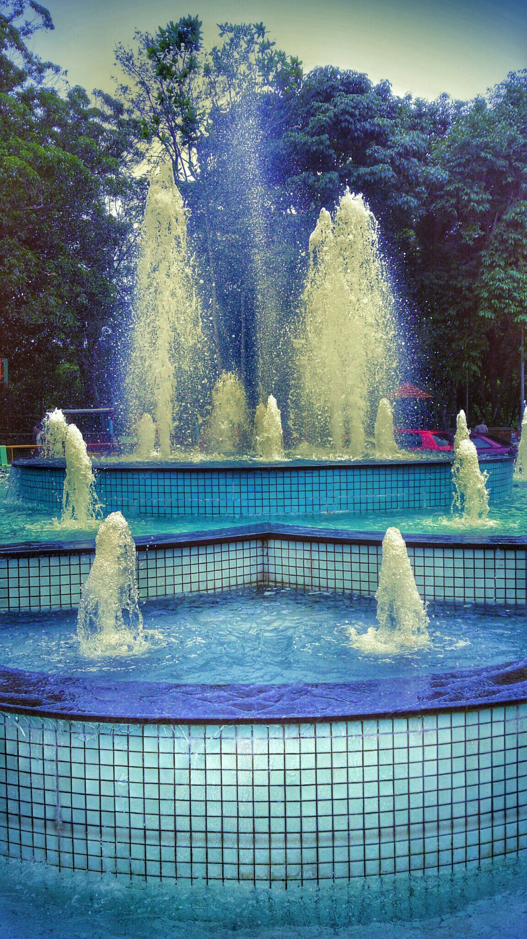 water, fountain, spraying, motion, splashing, blue, railing, long exposure, built structure, swimming pool, statue, flowing water, sculpture, tree, waterfall, architecture, art, art and craft, creativity