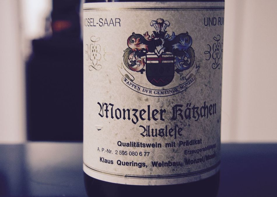 close-up old wine bottle, riesling mosel Close Up Close-up Communication Drink Enjoying Life Focus On Foreground Food Food And Drink Germany Indoors  Lifestyle Minimalism Mosel Organic Rheinland-Pfalz  Riesling Simplicity Text Traditional Weathered Western Script White Wine Wine Wine Bottle Wineandmore