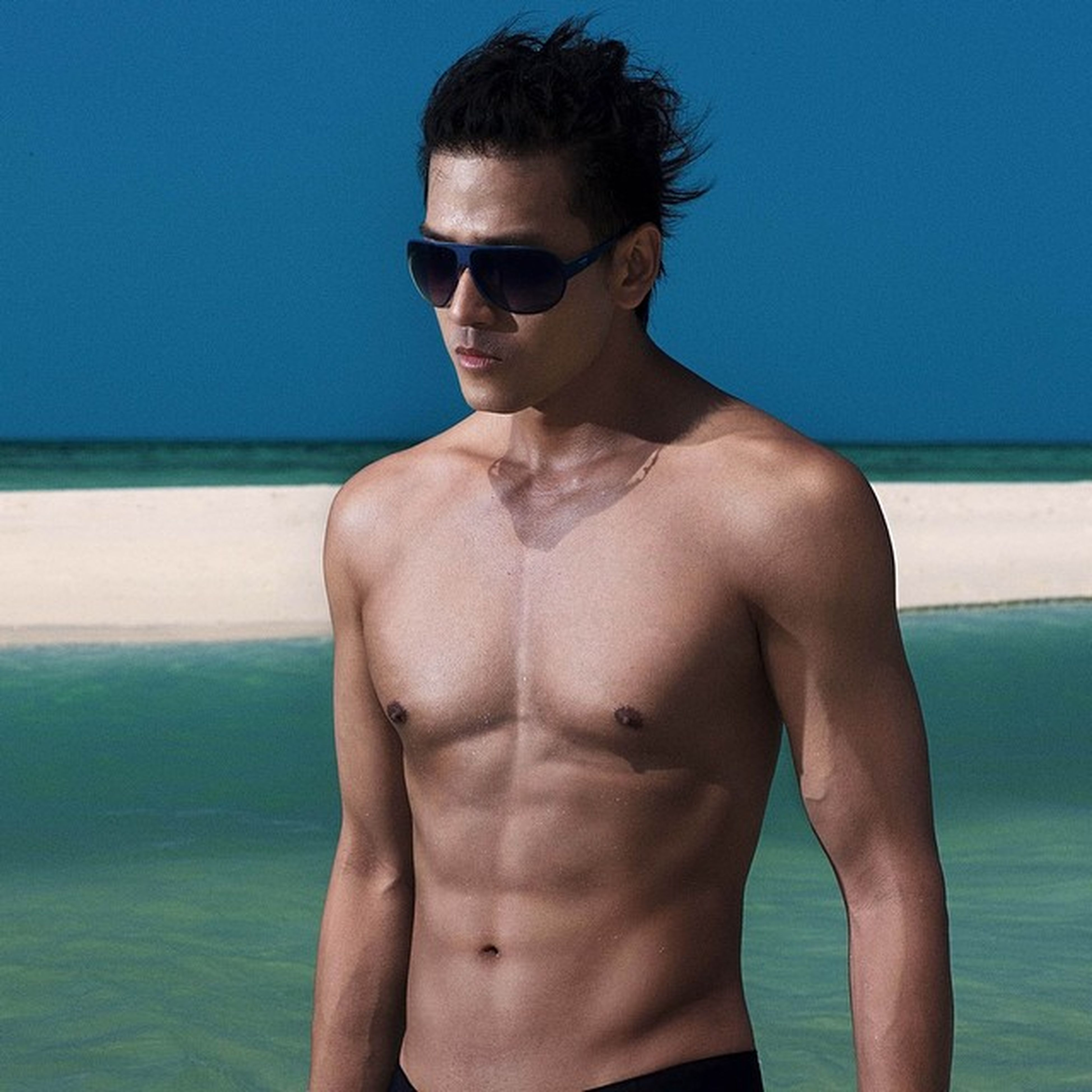 sea, young adult, water, person, young men, lifestyles, shirtless, looking at camera, portrait, leisure activity, horizon over water, beach, clear sky, front view, headshot, copy space, sunglasses, mid adult