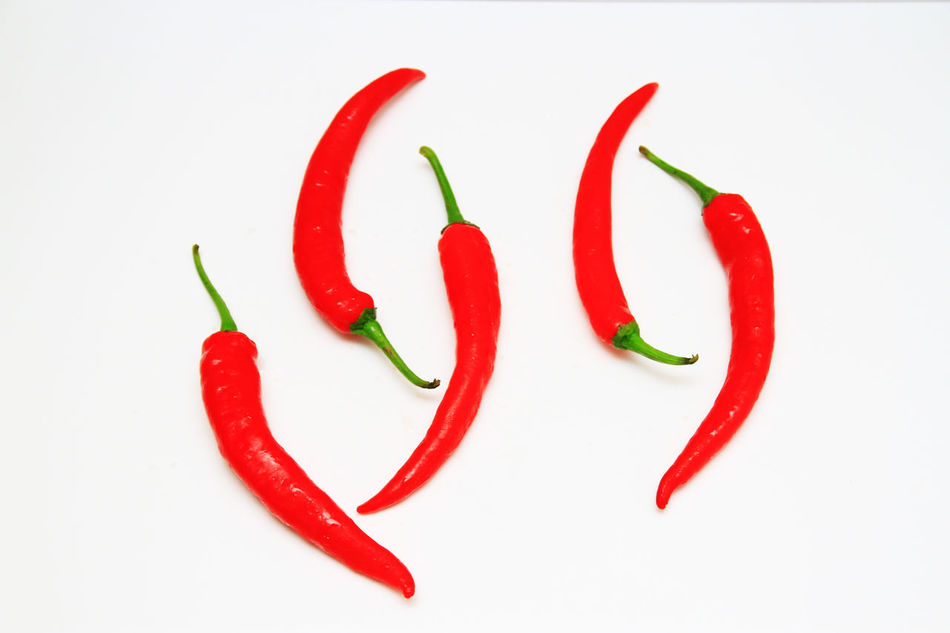 red chili pepper usually use in cooking Chili  Chili Pepper Chilies Close-up Food And Drink No People Red Red Chili Pepper Spicy Spicy Ingredient White Background