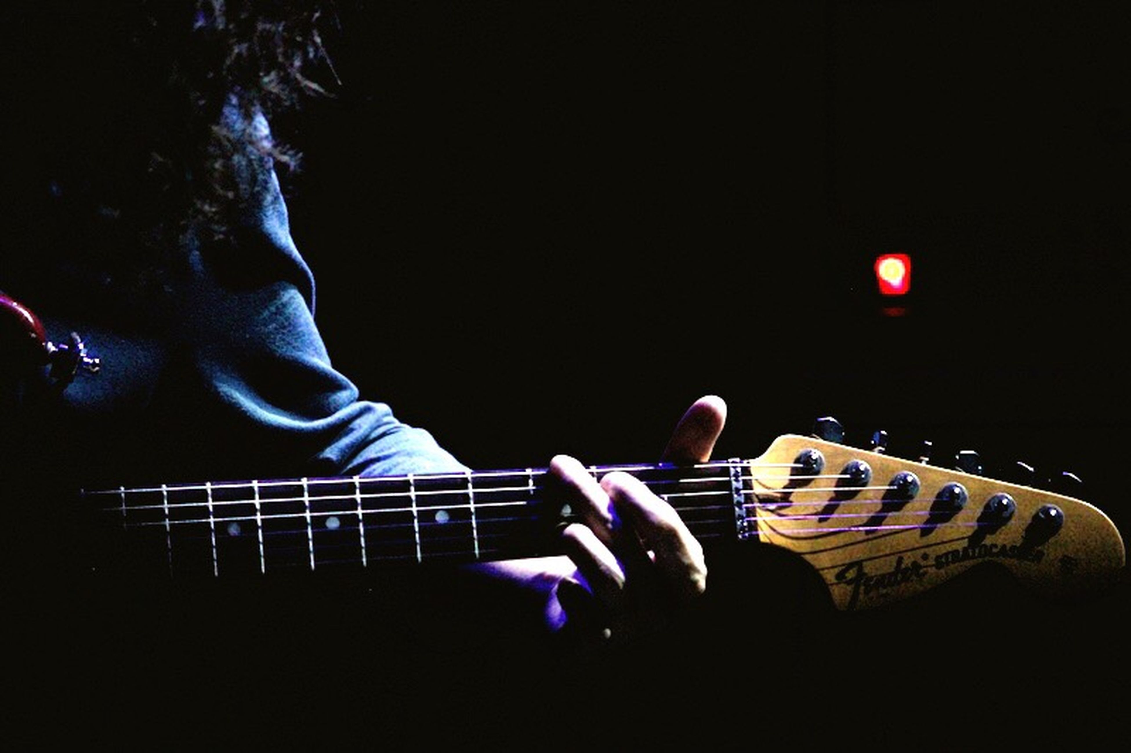 night, arts culture and entertainment, men, lifestyles, music, leisure activity, copy space, illuminated, musical instrument, skill, performance, person, occupation, side view, rear view, clear sky, guitar, casual clothing