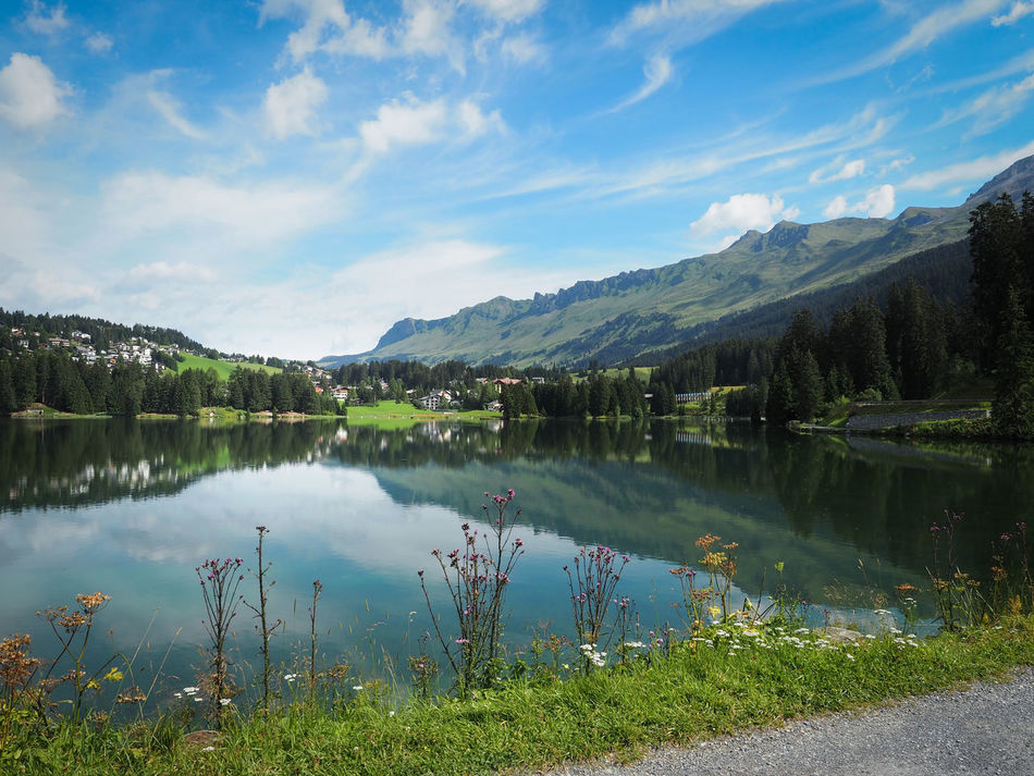 Beauty In Nature Blue Cloud Cloud - Sky Countryside Day Grass Heidsee Idyllic Lake Landscape Lenzerheide Mountain Mountain Range Nature Non-urban Scene Plant Reflection Scenics Sky Switzerland Tranquil Scene Tranquility Tree Water