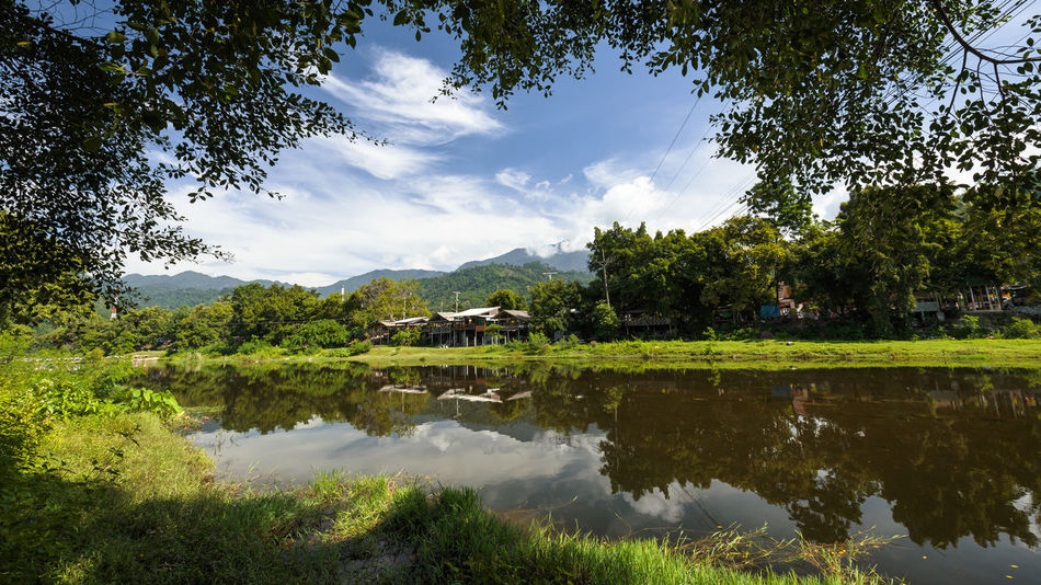 Kiriwong village Beauty In Nature Clear Water Cloud - Sky Countryside Day Forest Green Color Growth Idyllic Kiriwong Lake Mountains Nature No People Outdoors Plant Reflection Scenics Still Life Tranquil Scene Tranquility Tree Urban Water Waterfront