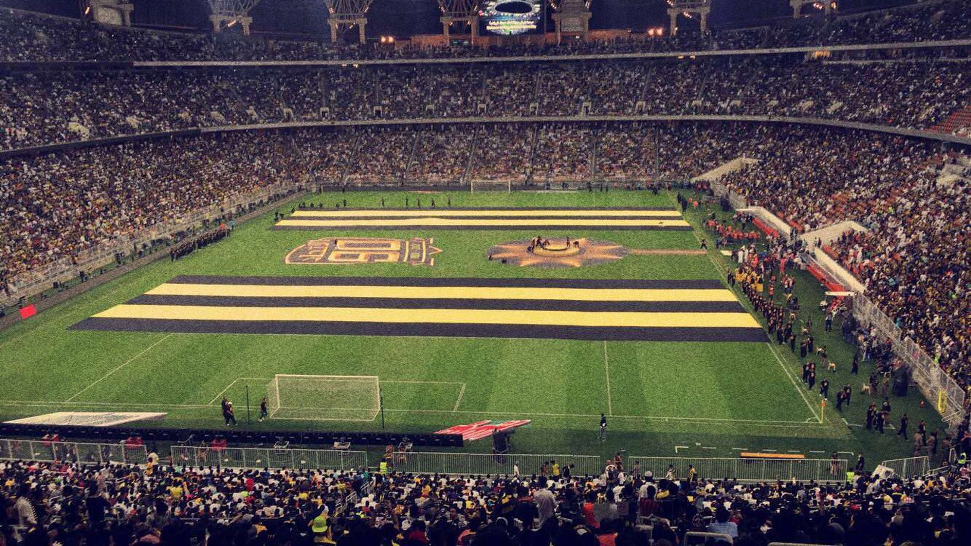 sport, stadium, large group of people, soccer, spectator, fan - enthusiast, sports team, night, crowd, people, bleachers, match - sport, audience, outdoors, soccer player, american football - sport, cheering, adult