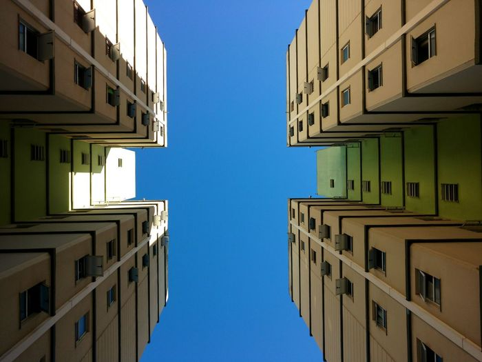 The Architect - 2017 EyeEm Awards Architecture Window Apartment Day Sky Clear Sky Blue City Santoandre Citysantoandre Symmetry EyeEmNewHere Be. Ready.