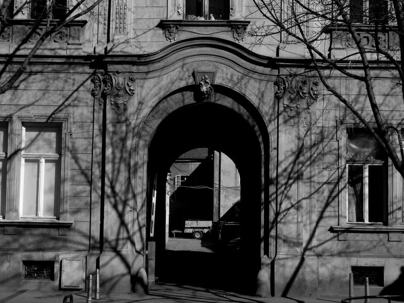 Arch Architecture Blackandwhite Building Exterior Built Structure City Day Façade Historic History No People Old Outdoors Shadow Streetphotography Symetry Trees Window Windowframe Zagreb The City Light