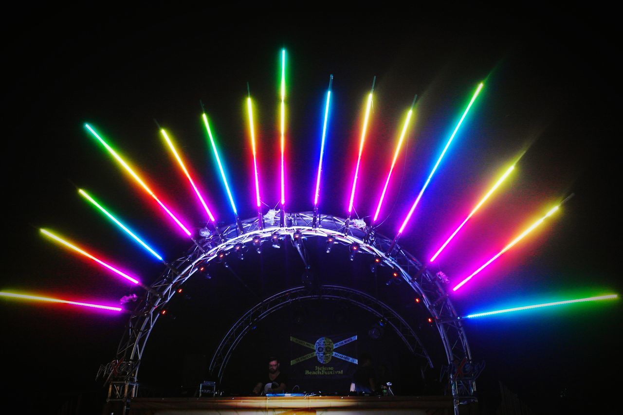 illuminated, night, multi colored, real people, arch, light beam, arts culture and entertainment, stage light, large group of people, indoors, popular music concert, people
