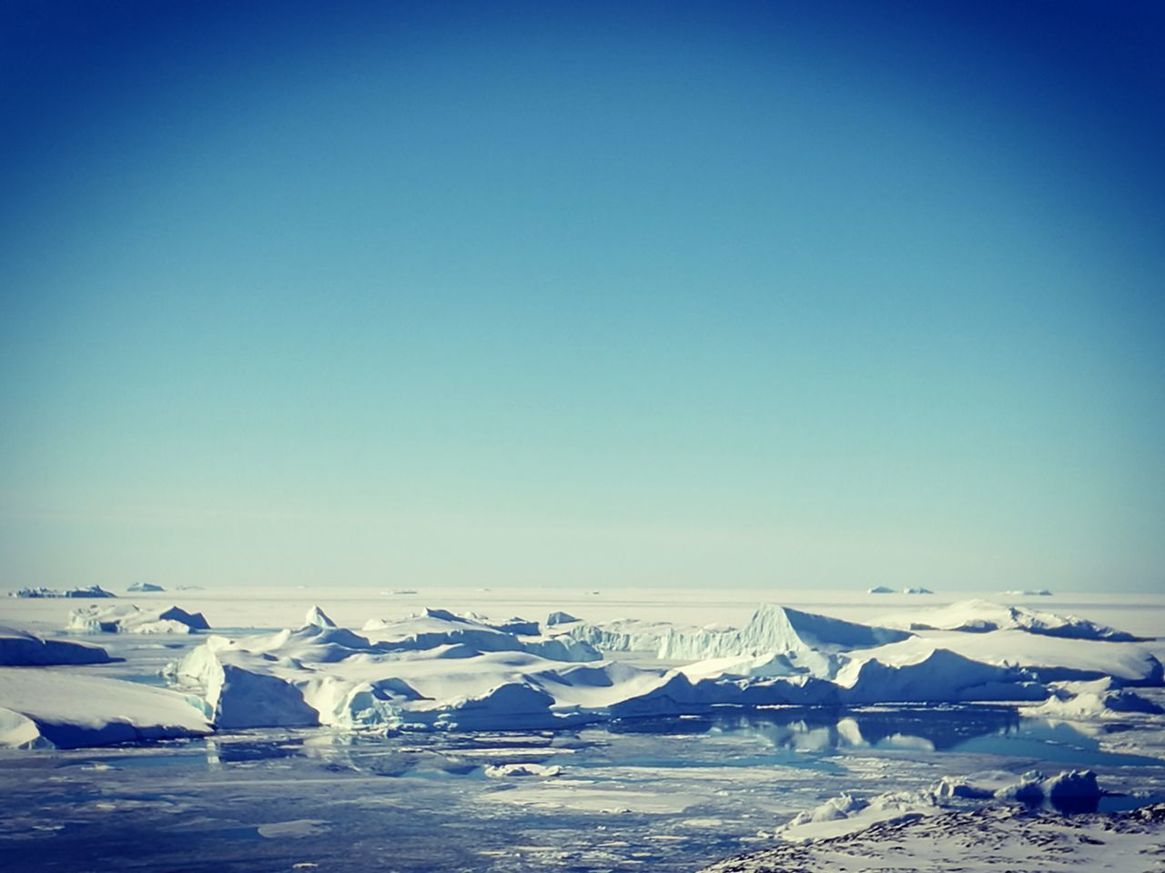 cold temperature, clear sky, copy space, blue, winter, ice, snow, frozen, no people, outdoors, nature, water, day, scenics, glacier, mountain, beauty in nature, iceberg, sea, sky, salt - mineral