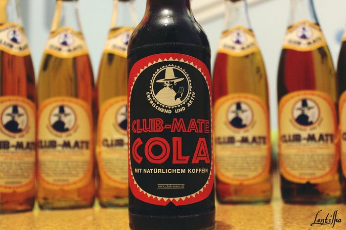 Focus On Foreground No People Indoors  Close-up In A Row Large Group Of Objects Multi Colored Lentilka Clubmate Clubmate Cola Drink Glasbottle Yellow Orange Black Canonphotography Canon Defocused Background EyeEmNewHere Klettgau Oldpicture Oldphoto Lieblingsteil