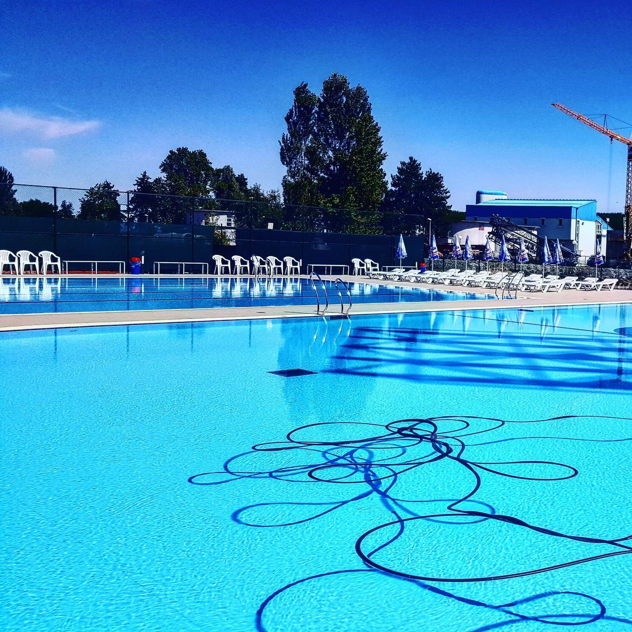 swimming pool, tree, blue, water, outdoors, day, sky, no people, architecture, nature