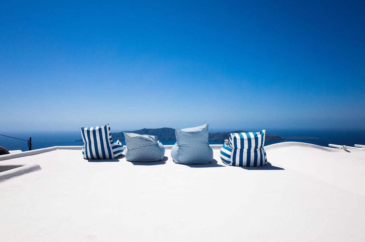 Seats On Terrace Against Clear Blue Sky
