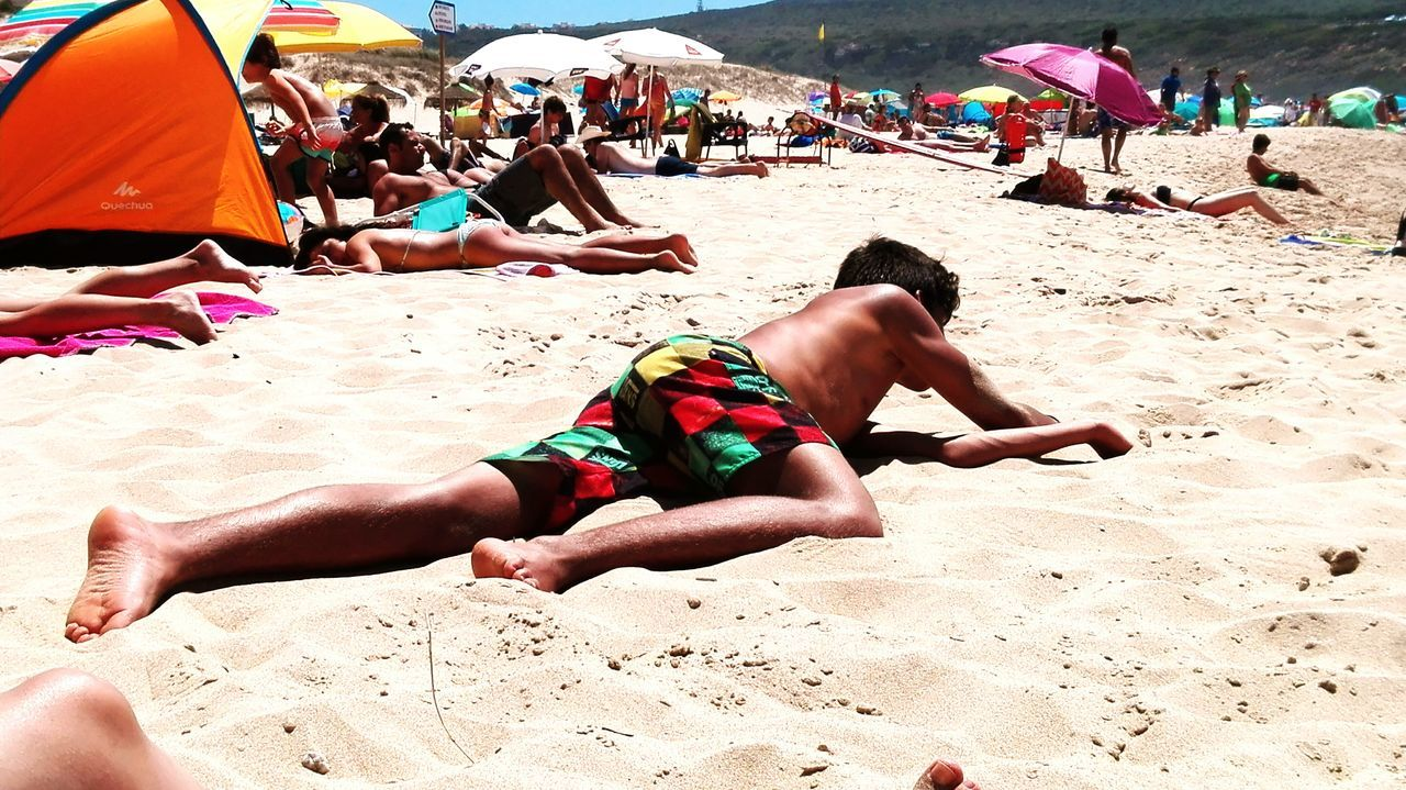 My son Beach Sand Vacations Summer Large Group Of People Sunbathing Leisure Activity Outdoors Day Real People Relaxation Sitting Lifestyles Shirtless Travel Destinations People Sea Adult Men sand bath