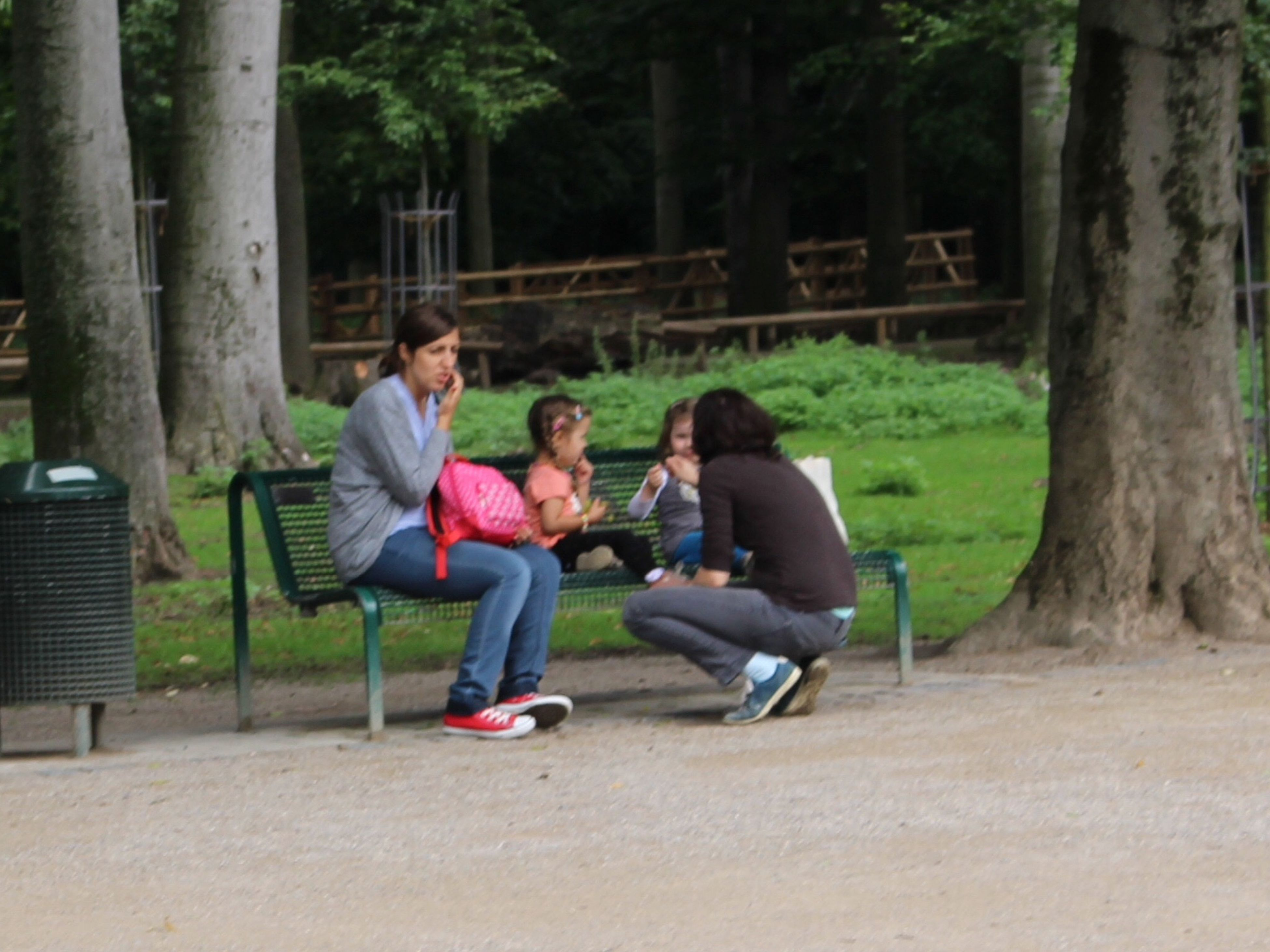 lifestyles, leisure activity, togetherness, full length, casual clothing, bonding, tree, person, love, sitting, childhood, boys, young adult, friendship, family, park - man made space, girls, enjoyment