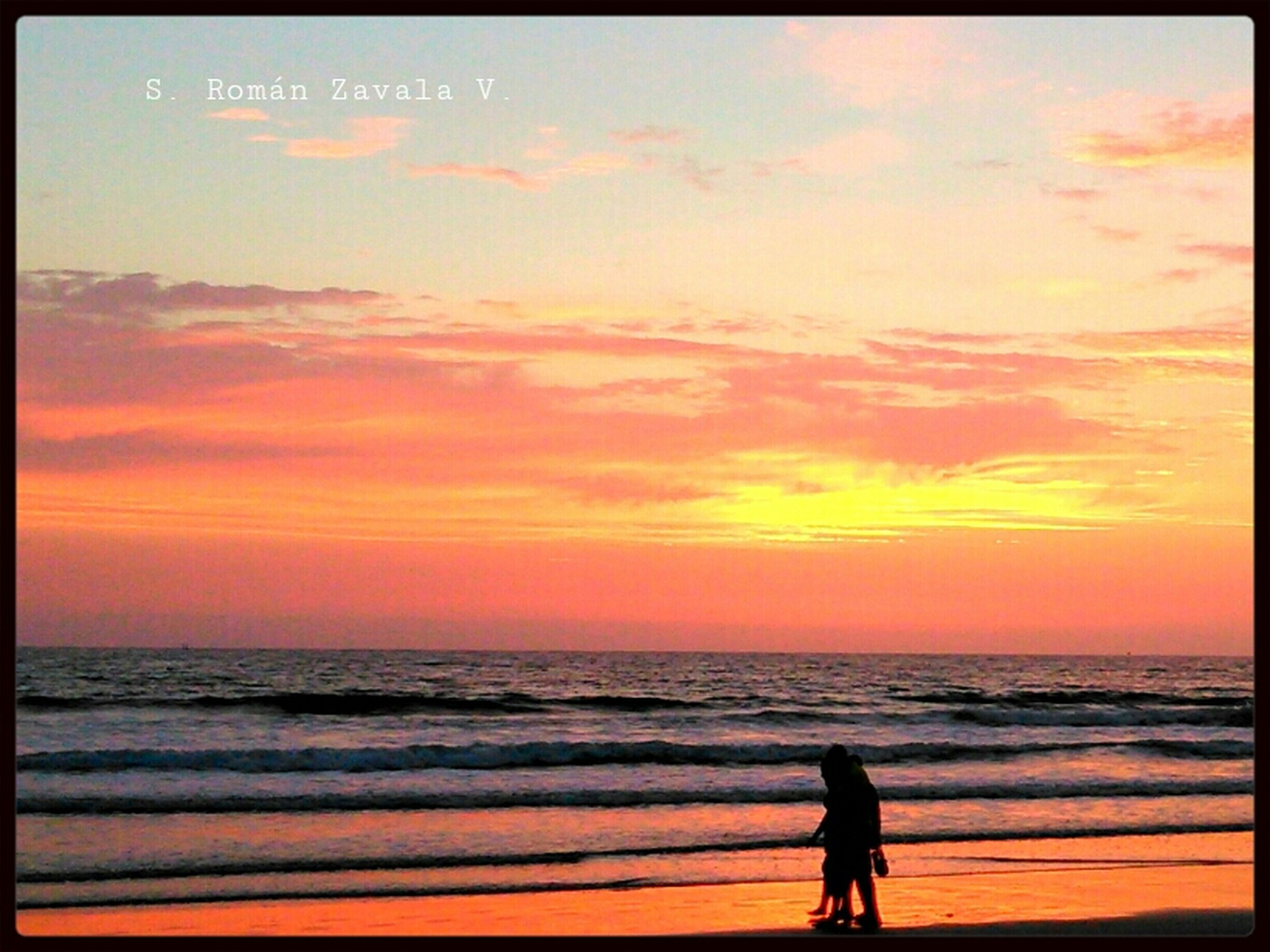sea, horizon over water, sunset, water, beach, orange color, scenics, sky, transfer print, beauty in nature, silhouette, tranquil scene, shore, tranquility, lifestyles, leisure activity, standing, auto post production filter