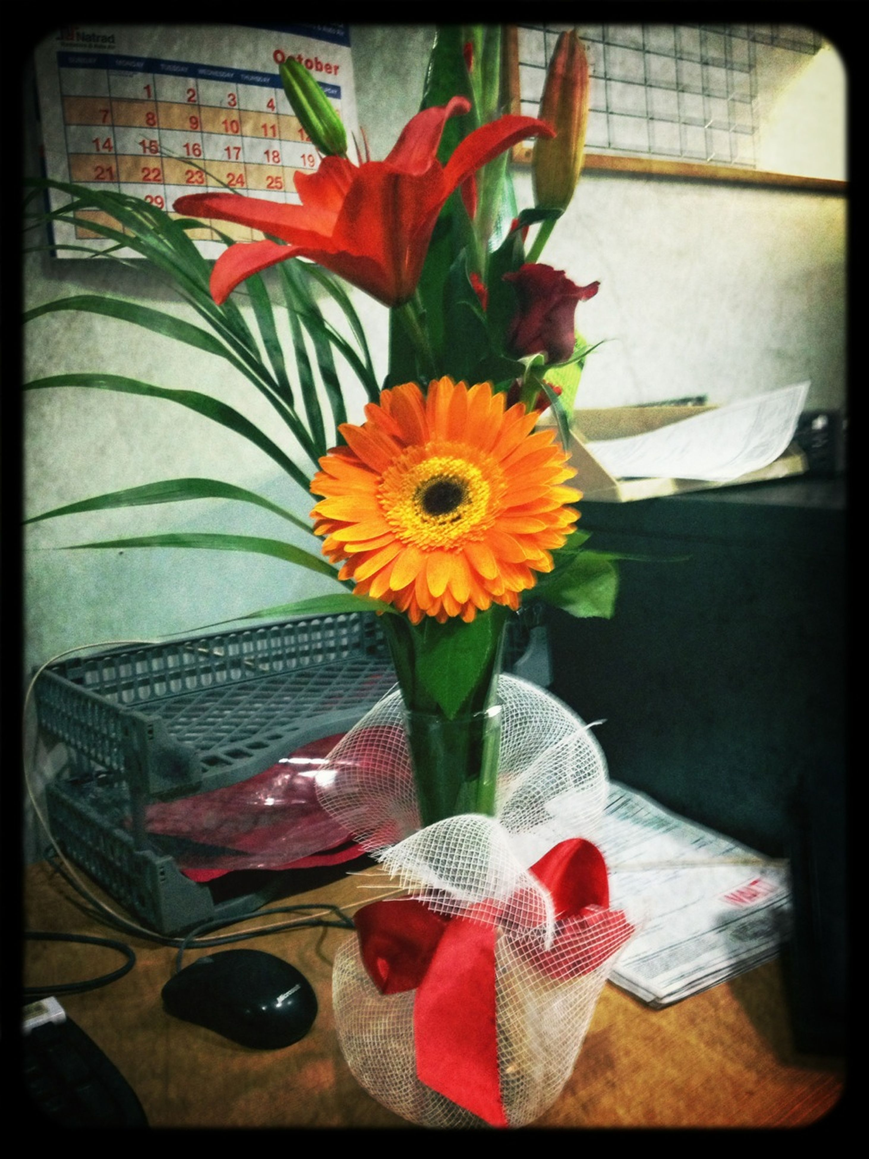 indoors, flower, transfer print, vase, table, petal, fragility, home interior, auto post production filter, flower head, freshness, multi colored, yellow, high angle view, still life, flower arrangement, potted plant, chair, close-up, no people