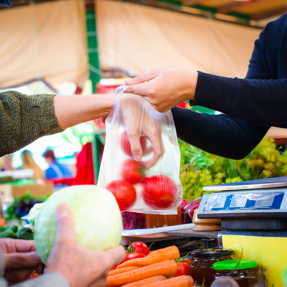 selling and buying fresh vegetables on market Bag Cabbage Carrots Choice Customer  Day Food Food And Drink For Sale Freshness Healthy Eating Holding Human Body Part Human Hand Lifestyles Market Market Stall Outdoors People Plastic Real People Retail  Tomatoes Vegetable
