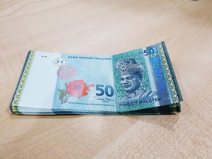 ringgit Malaysia money Business Finance And Industry Business Money Around The World Money Ringgit Ringgit Malaysia 50ringgit Finance Single Object Currency Paper Currency Wealth Business Finance And Industry Savings Business Close-up Crumpled Paper