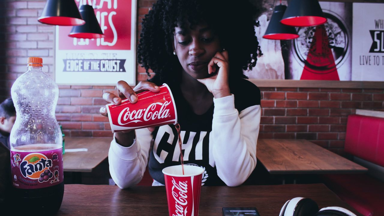 Drink Indoors  People Day BreAkfAst 💕 EyeEm Gallery Pizza Hut Resturant Canonphotography EyeEm Cups Morning Lady Black Hair Canon Camera Africa Beauty Young Adult Coca-cola Red Black And White Fashion EyeEmNewHere