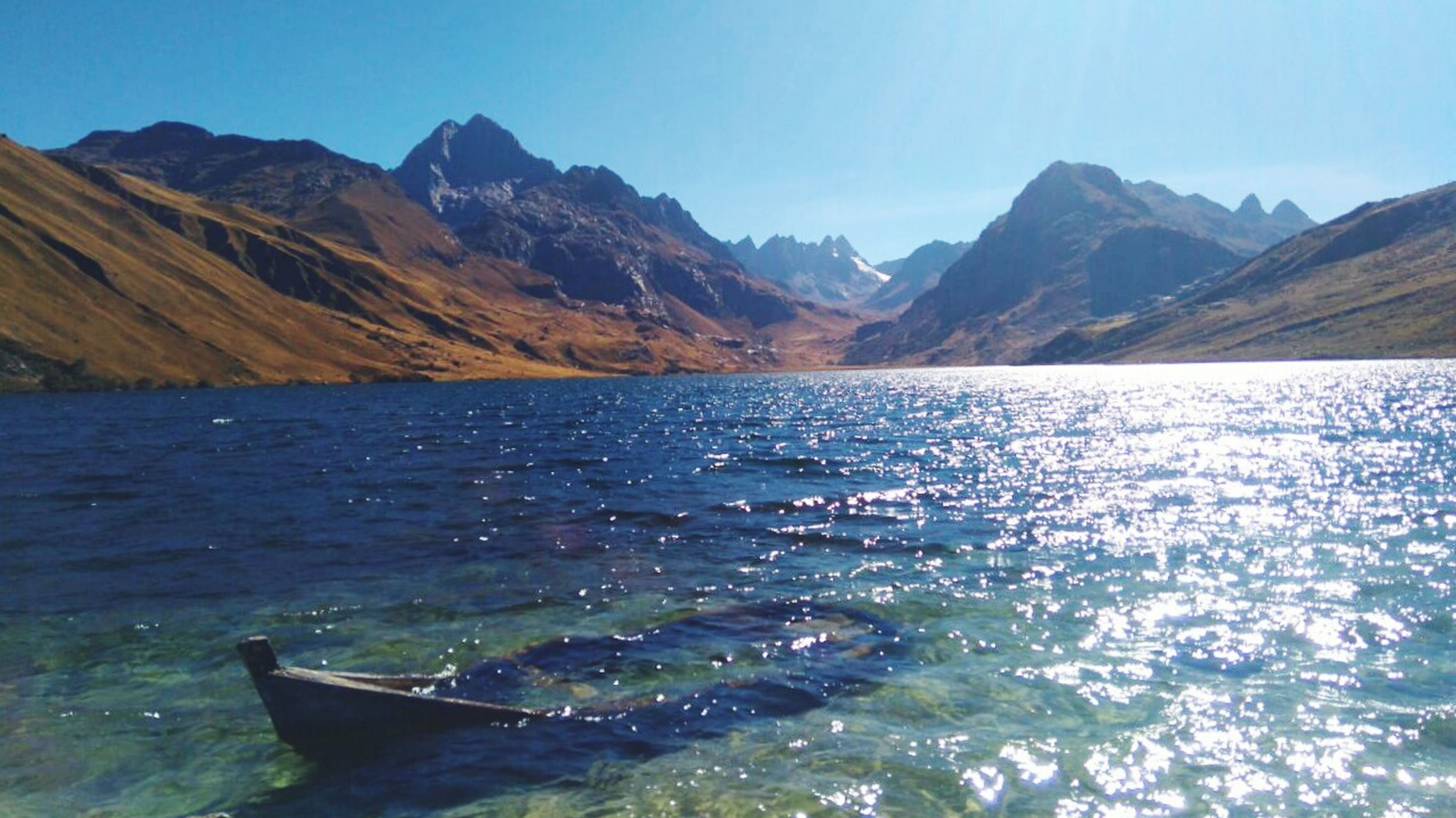 mountain, water, mountain range, tranquil scene, scenics, tranquility, lake, beauty in nature, nature, idyllic, blue, non-urban scene, rippled, day, sky, outdoors, remote, no people, landscape, non urban scene, majestic