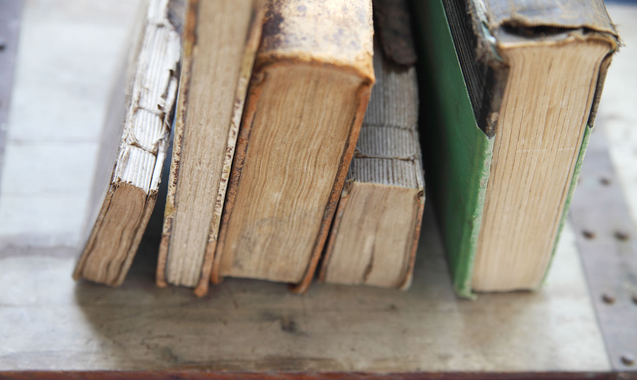 Vintage book textures with copy space Antiques Beige Tones Book Bindings Copy Space Damaged Deterioration Education Gray Indoors  Literature Natural Light No People Nobody Old Pages Textures Vintage Books Weathered Wood Surface Worn