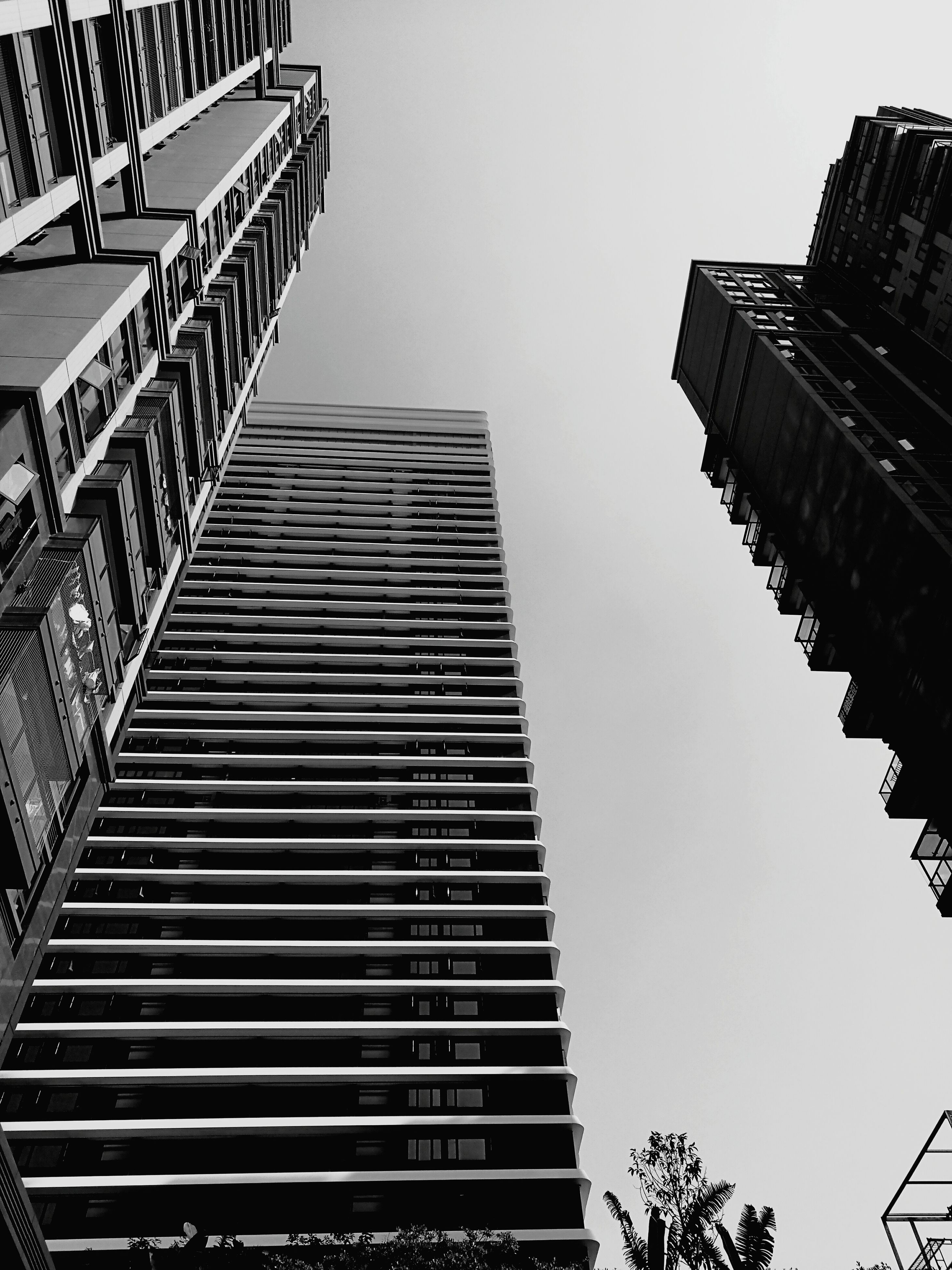 low angle view, architecture, building exterior, built structure, tall - high, skyscraper, city, tower, office building, sky, clear sky, modern, outdoors, building story, day, urban skyline, city life, capital cities, no people, financial district