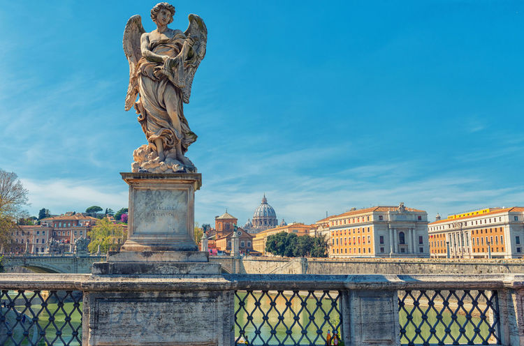 Saint angel bridge with Angel statue Rome Saint Angel Castle Angel Architecture Art And Craft Bridge - Man Made Structure City Day Human Representation Italy No People Outdoors Sculpture Statue
