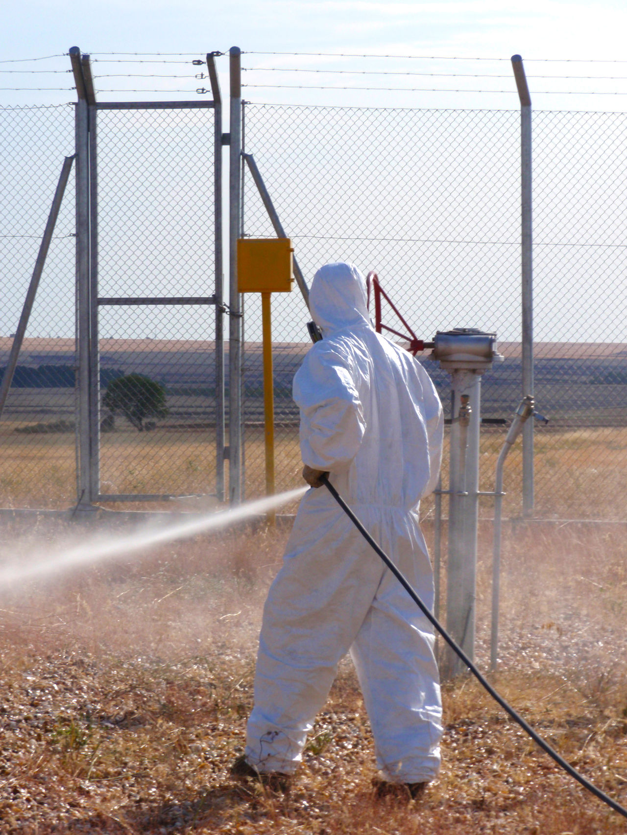 Fumigate Fumigating Fumigation  Gas Gas Mask Herbicide Man Man Working One Person Pest Pest Control Pipeline Plague Poison Poisonous Pulverize Real People Safety Security Spray Spraying Toxic Work Place Working Workplace