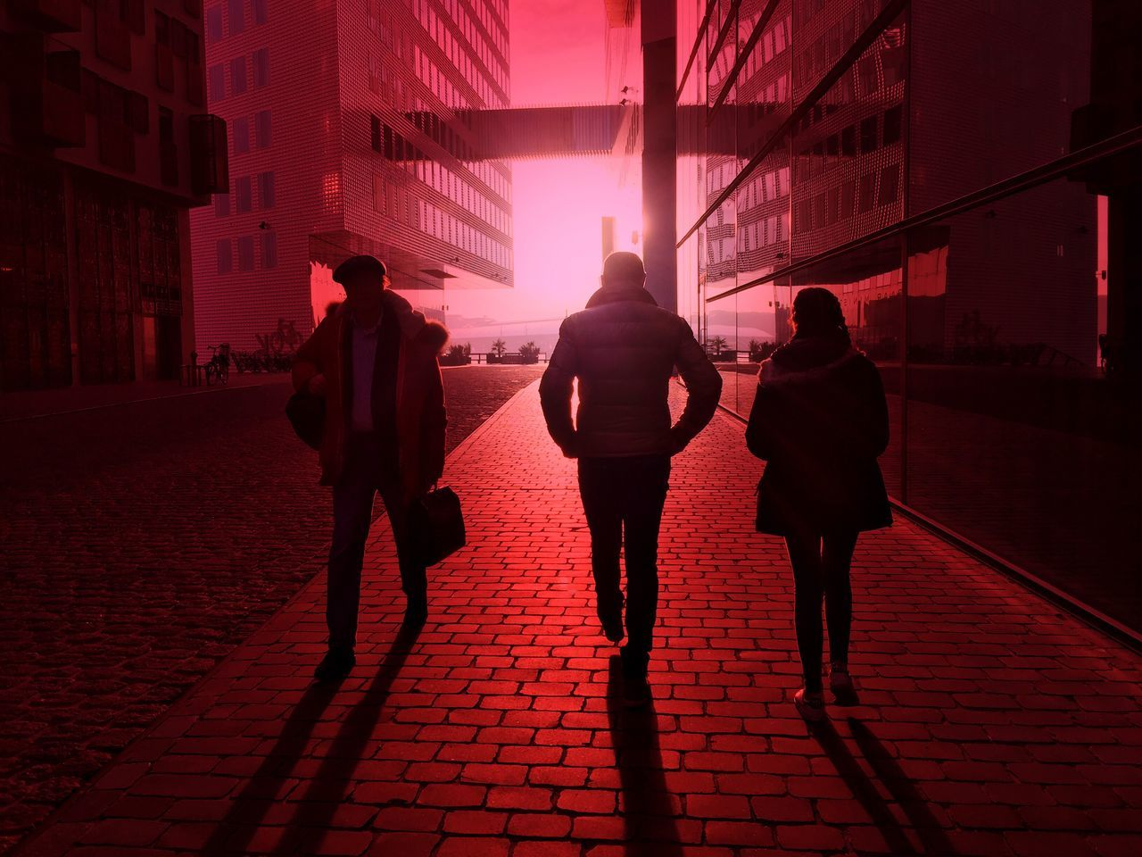 walking, full length, real people, rear view, building exterior, architecture, silhouette, sunlight, outdoors, built structure, sunset, city, red, women, lifestyles, modern, togetherness, men, friendship, day, sky, people