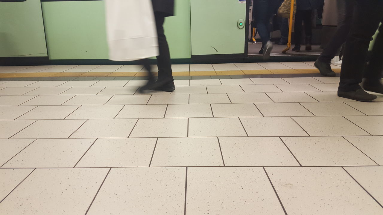 Low Section Of People At Railroad Station Platform