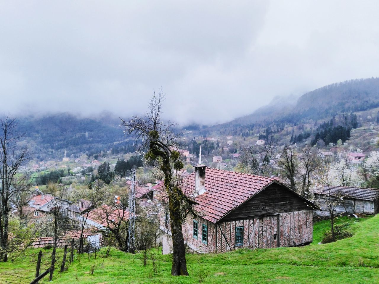 architecture, built structure, tree, no people, mountain, day, beauty in nature, nature, house, building exterior, sky, outdoors, scenics, tranquility, landscape, grass
