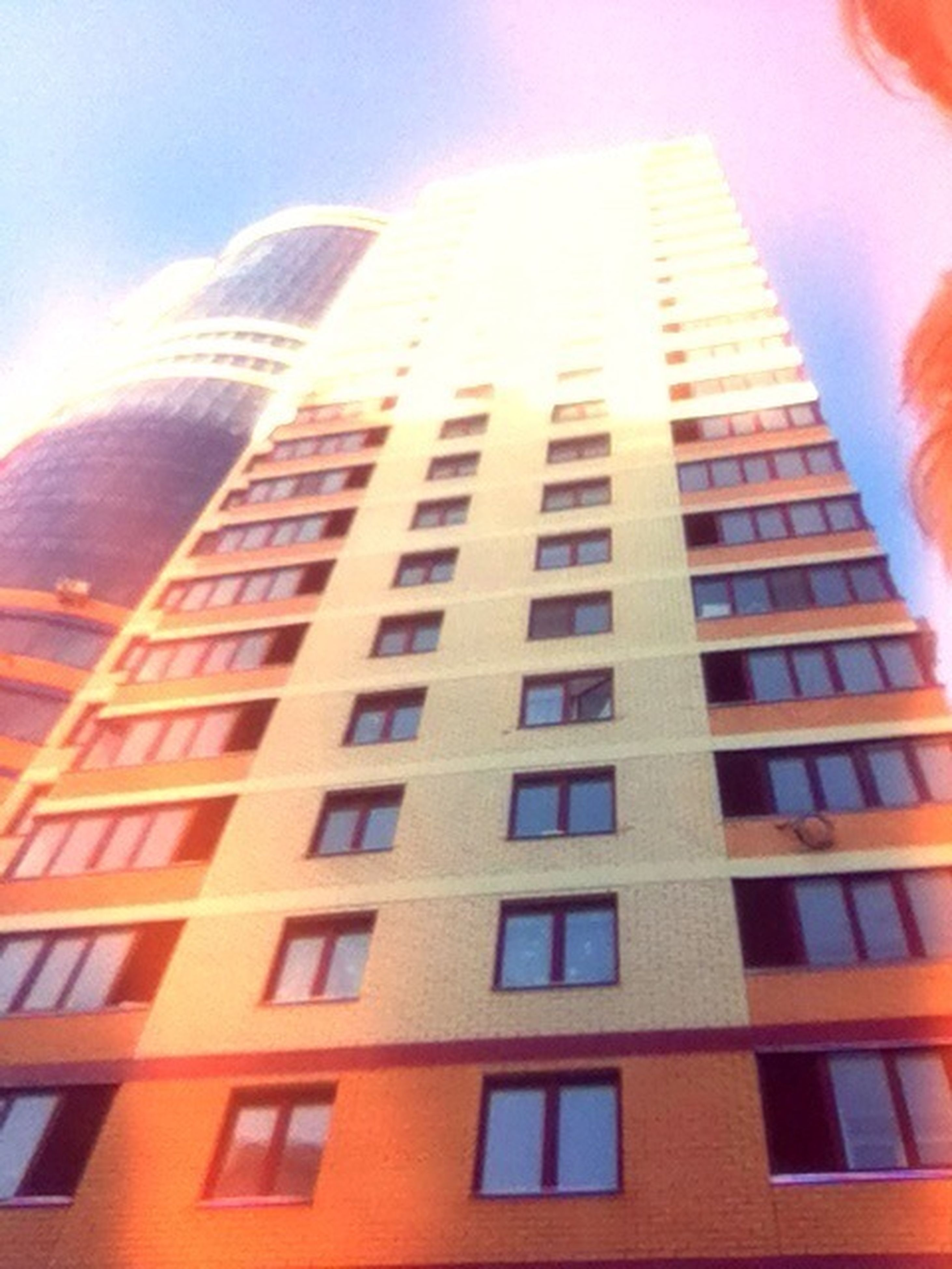 architecture, building exterior, low angle view, built structure, window, city, modern, building, glass - material, office building, skyscraper, tall - high, sky, reflection, tower, day, no people, outdoors, residential building, sunlight