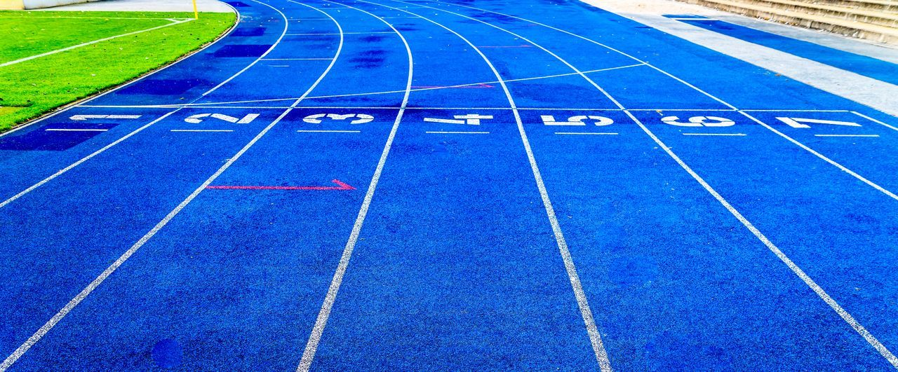 Blue Competition Competitive Sport Day Grass No People Number Outdoors Playing Field Running Track Sport Sports Race Sports Track Stadium Starting Line The Street Photographer - 2017 EyeEm Awards Track And Field Track And Field Event Track And Field Stadium Track Event