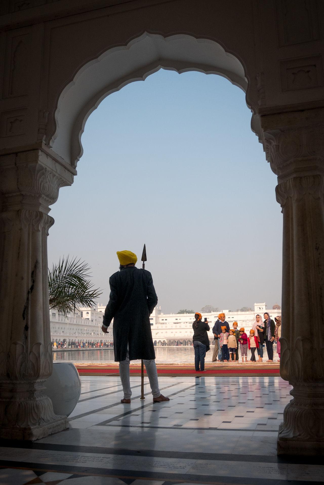 Guard in the Golden Temple, Amritsar, India Amritsar Arch Architecture Golden Golden Temple Guard Gurdwara Harmandir Sahib India Punjab Religion Security Sikh Sikh Temple Sikhism Sunlight Temple Travel Travel Destinations Worship