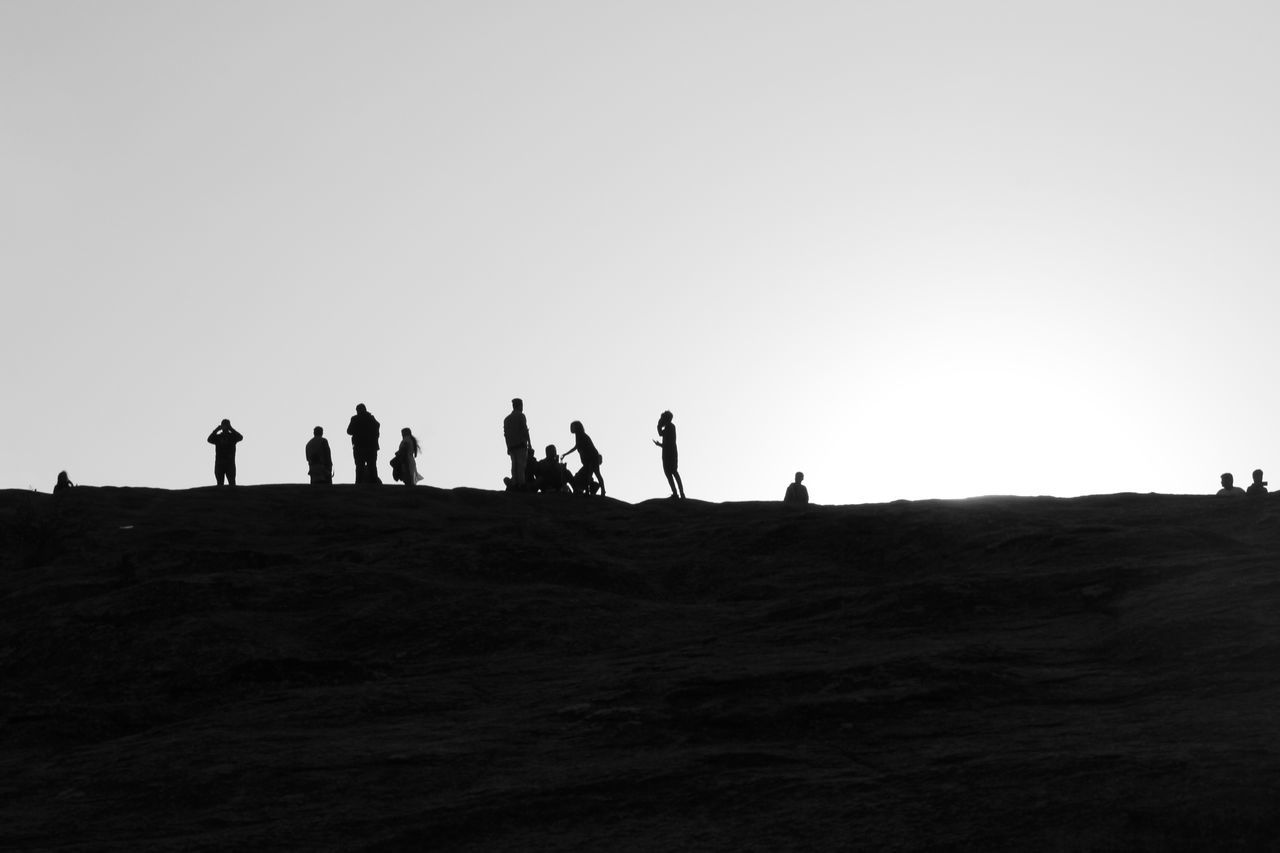 real people, silhouette, clear sky, copy space, large group of people, men, leisure activity, sky, outdoors, lifestyles, nature, women, landscape, day, vacations, adventure, scenics, full length, togetherness, beauty in nature, people