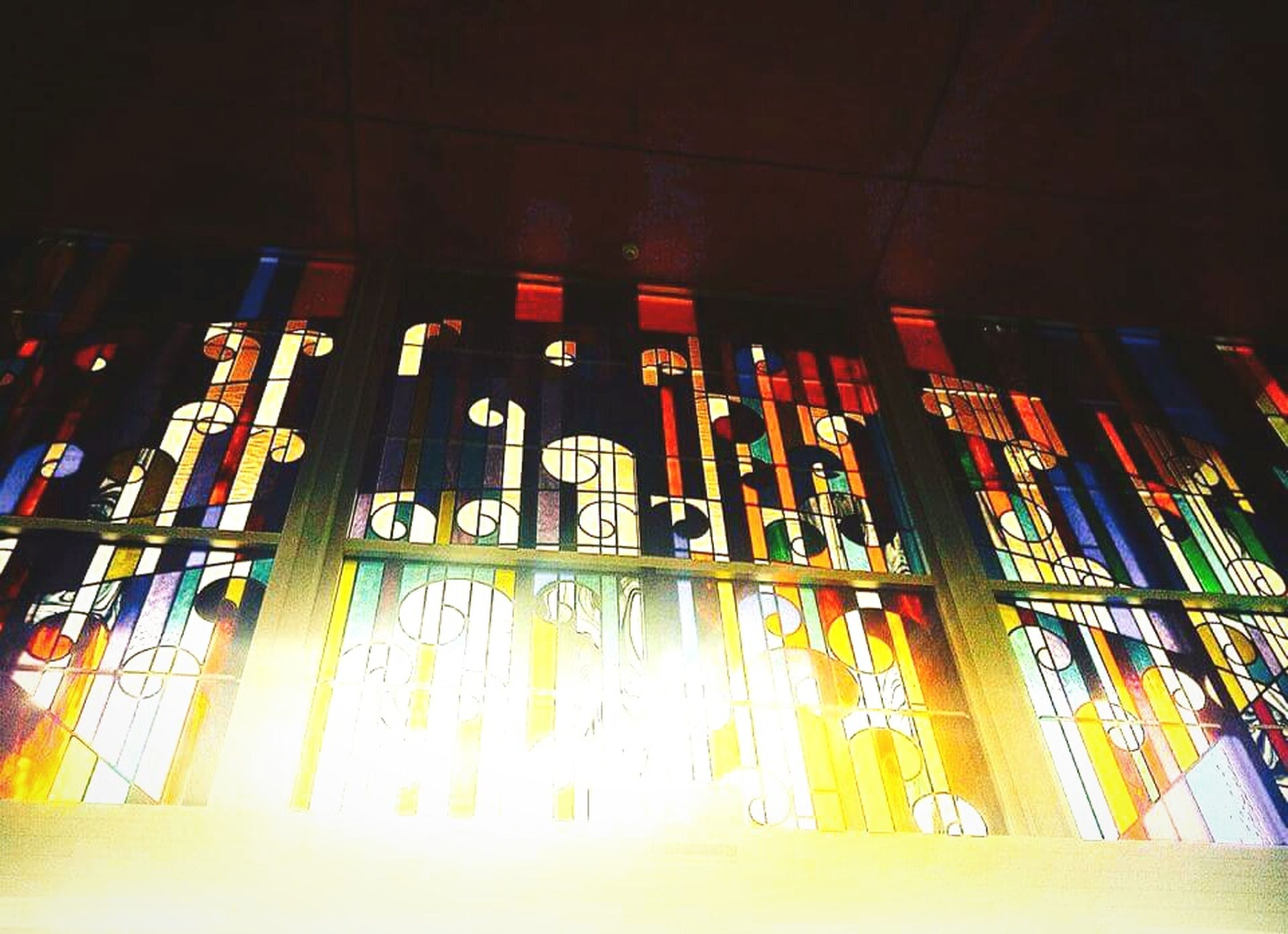 low angle view, architecture, indoors, built structure, in a row, hanging, illuminated, religion, place of worship, spirituality, side by side, repetition, no people, large group of objects, building exterior, order, multi colored, decoration, architectural column, temple - building