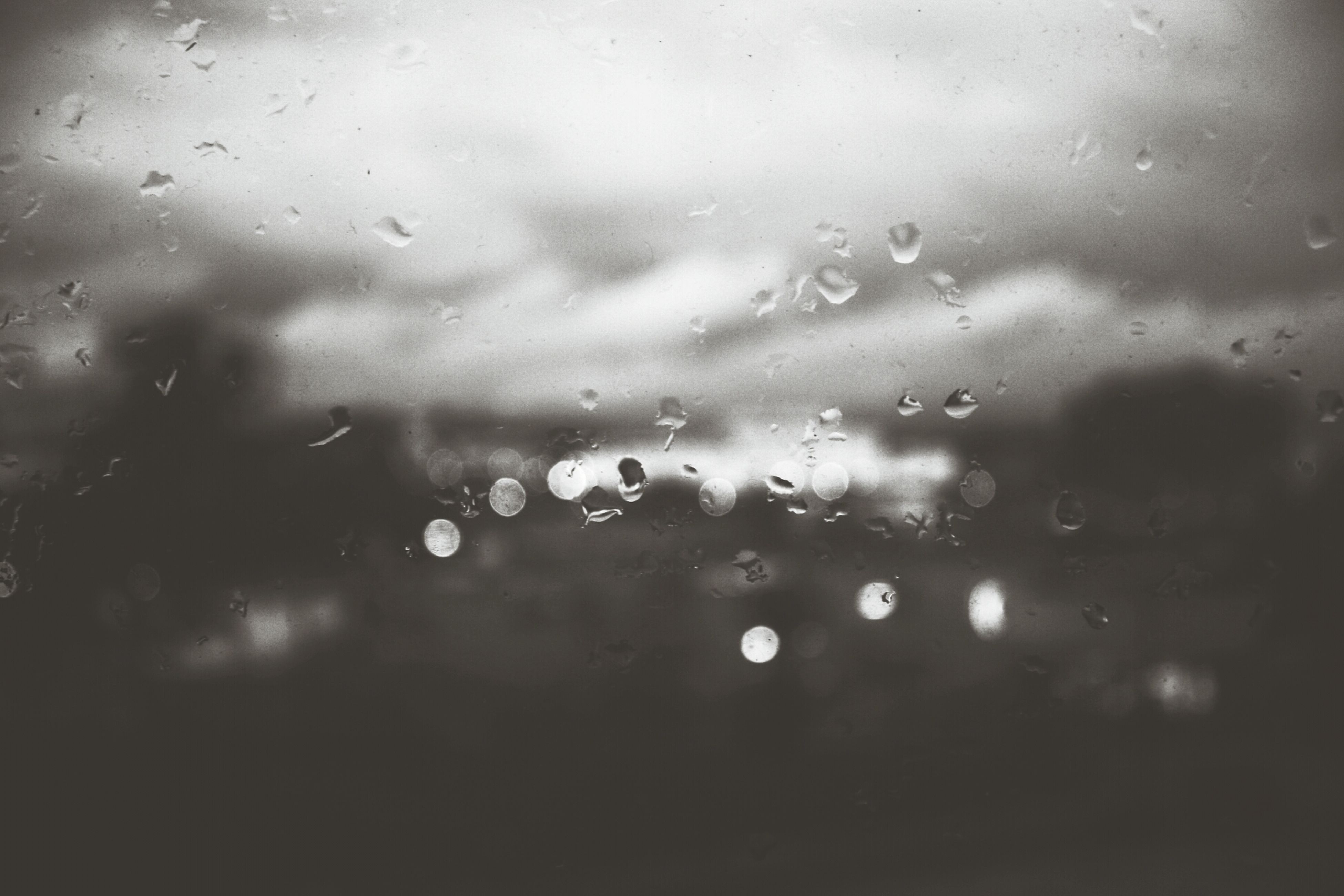 drop, wet, water, window, rain, transparent, indoors, raindrop, glass - material, weather, full frame, backgrounds, glass, focus on foreground, season, water drop, droplet, sky, close-up, nature
