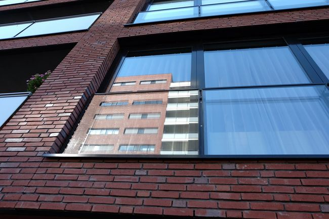 Architecture Blue Building Exterior Building Story Built Structure City City Life Day Full Frame Low Angle View Modern No People Office Building Outdoors Red Reflection Reflection Reflection In The Window Window