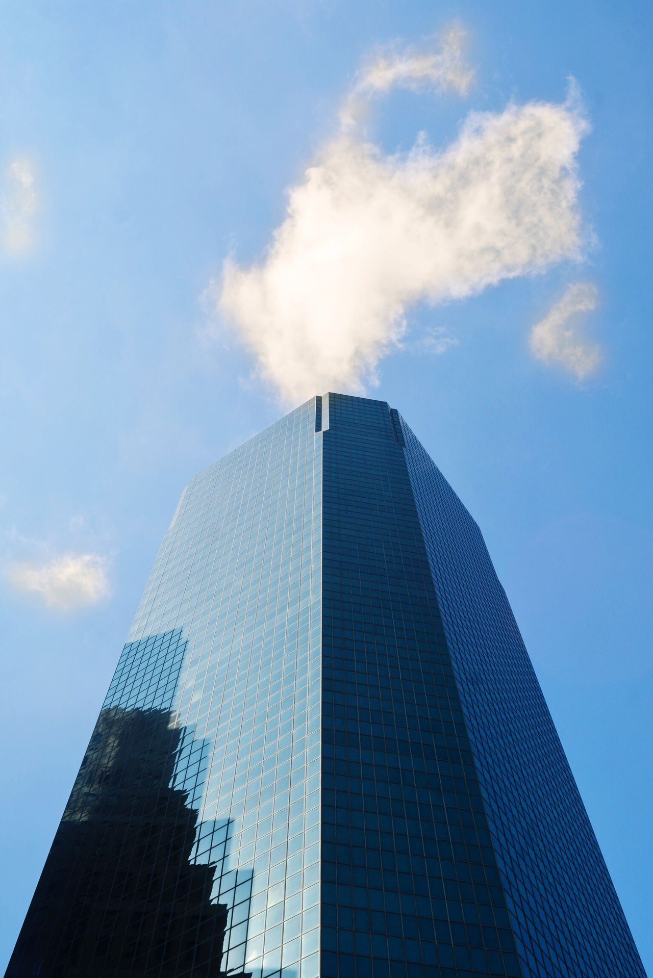 Smoke Emmitting Clouds. New York, USA. Architecture Building Exterior Low Angle View Built Structure Sky Skyscraper Modern No People City Day Outdoors Cloud - Sky Tall Chance Encounters