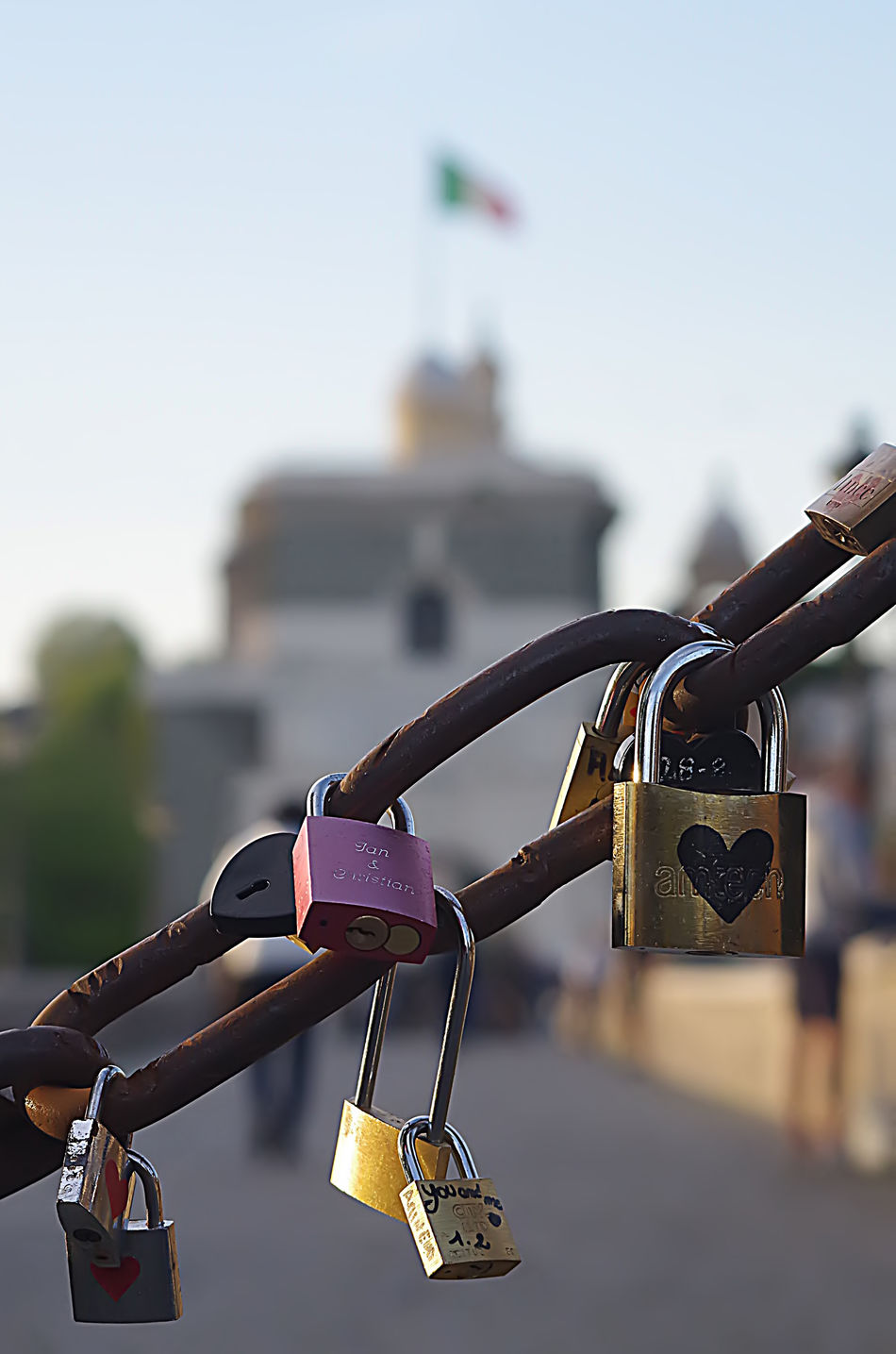 a series of locks of lovers in a famous rome bridge Bridge - Man Made Structure Chain Close-up Focus On Foreground Hanging Heart Shape Hope Hope - Concept Lock Love Love Lock Luck Metal No People Oath Outdoors Padlock Protection Railing Safe Safety Security Security System Trust Variation