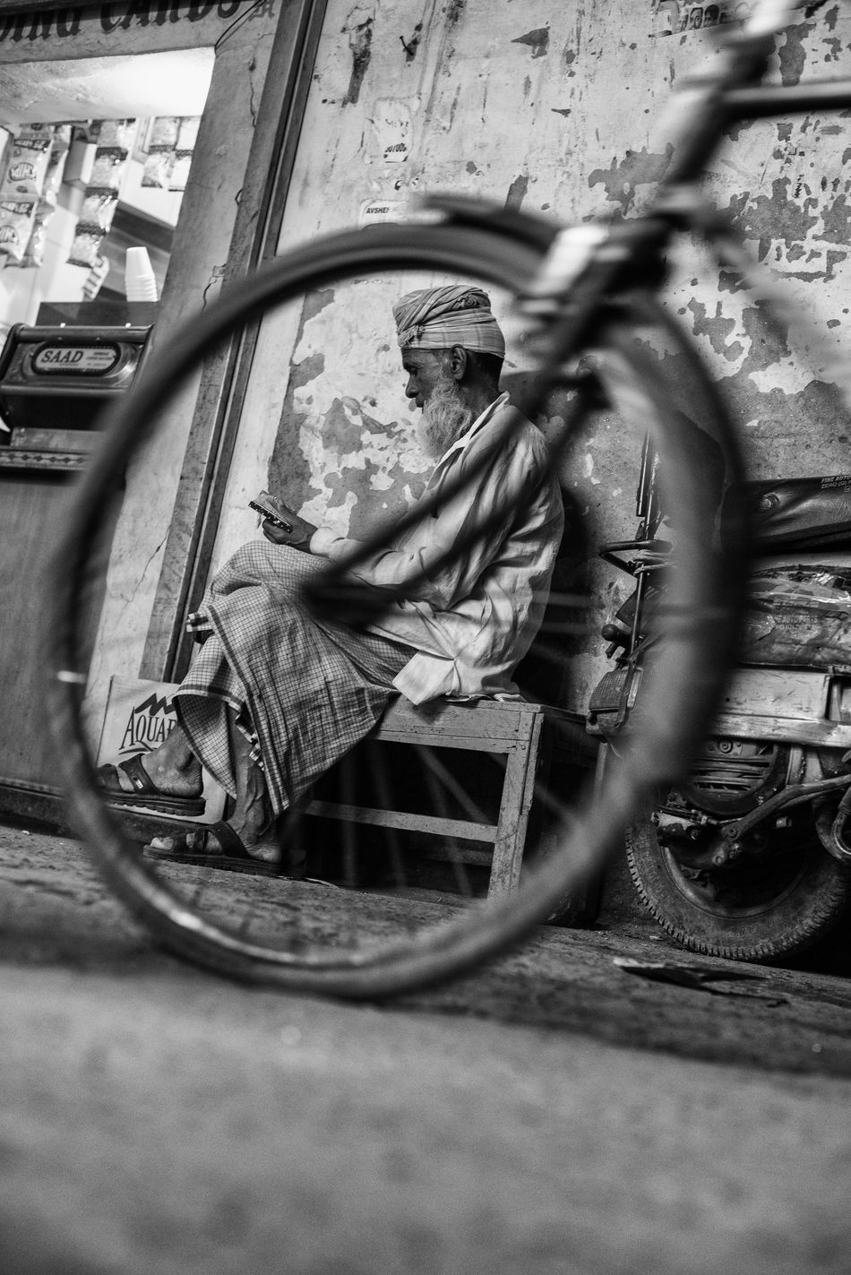 EyEmNewHere One Person Street Photography Old Delhi EyeEm Best Shots India Travel Chandnichowk New Delhi, India EyeEmNewHere Travel Destinations Low Perspective Street Life Bicycle Old Man Beard Man Reading Interesting Angles Black & White Indiapictures Nightlife Decisive Moment