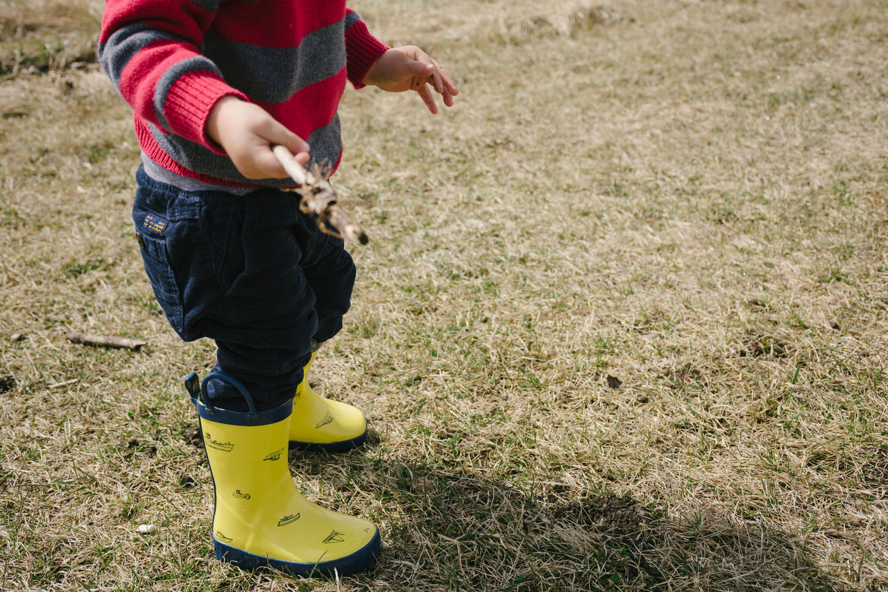 Little explorer Boy Casual Clothing Child Childhood Day Grass Lifestyles Nature Outdoors Park Rainboots Rubberboots Sweater Toddler  Wellington Boots