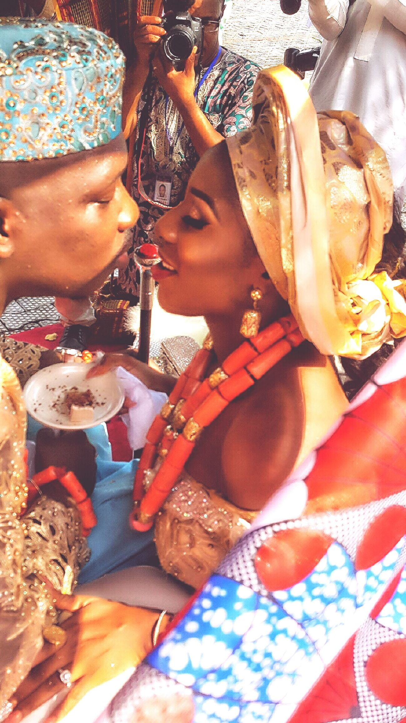 My big Brother from Nigeria and his Queen looking like Royalty Kiss Kiss ! Adults Only Gold Colored Couple Traditional Clothing Only Women Adult Cultures African Beauty Young Adult Women Young Women Outdoors Wedding Ceremony Day Stage Make-up People One Person One Young Woman Only African AMPt - My Perspective EyeEm Best Shots