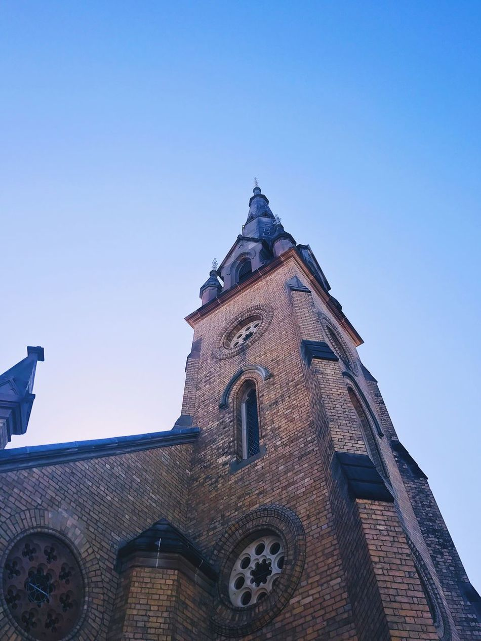 Looking up Religion Low Angle View Architecture Place Of Worship Built Structure Spirituality Building Exterior Clear Sky No People Day Outdoors Blue Sky Clock Tower Bell Tower Place Of Worship Tranquil Scene Clear Sky Beautiful Church Churches Building Exteriors Building (null)Scenics